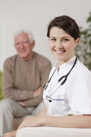 health care facility: Happy old man and smiling young nurse