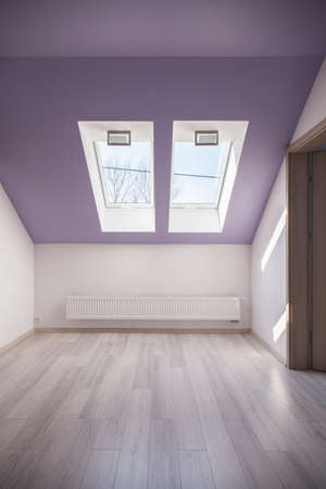 attic: Violet slanted ceiling in empty attic room