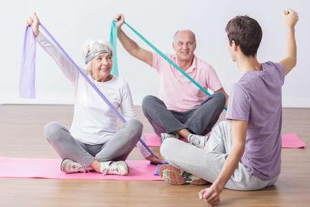 senior exercising: Image of elderly people do physical exercises for health