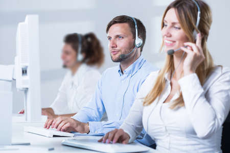 headset computer: Young man is talking with new customer