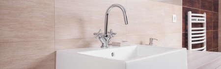 washbasin: Close-up of porcelain washbasin on beige background