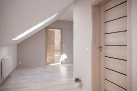 Interior of beige room at the attic