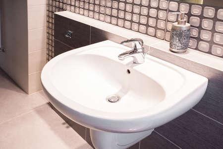 washbasin: Close-up of porcelain washbasin in luxury bathroom