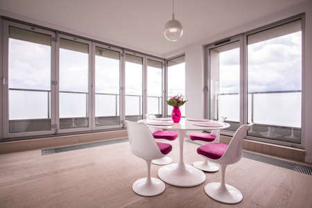dining: White round table in modern dining room