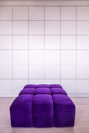 pouf: Modern violet couch in empty contemporary interior Stock Photo