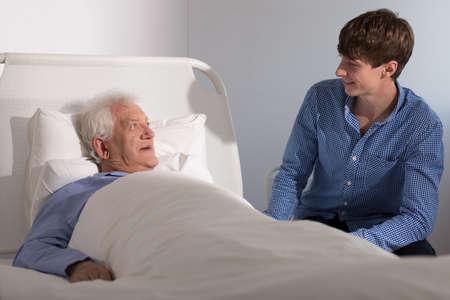 hospice: Elderly hospice patient with a young caregiver Stock Photo