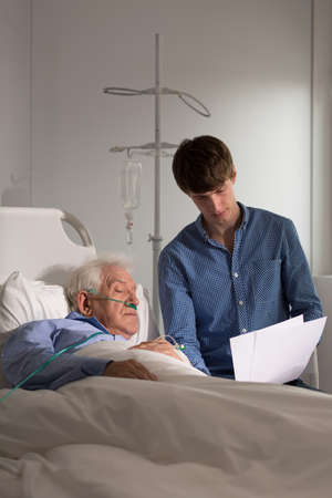 geriatrics: Elderly in hospital looking at lab test results