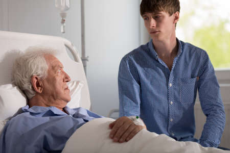 ailing: Care assistant with senior patient in hospice Stock Photo