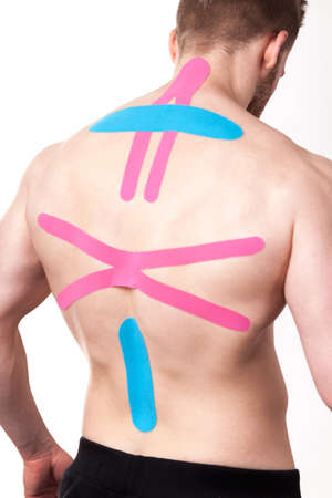 spinal disks: Man with kinesio taping applications for back pain