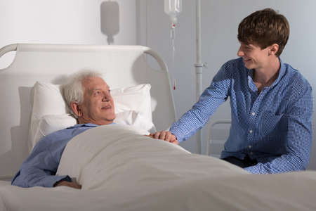 recovering: Grandson is visiting his grandfather recovering in hospital