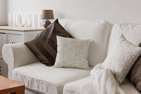cosy: White comfortable cosy sofa with pillows