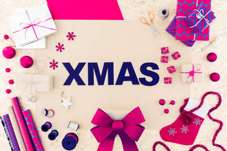 text word: Xmas word written in capital letters and christmas decorations