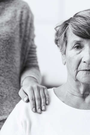 Image of elderly sick woman with alzheimer