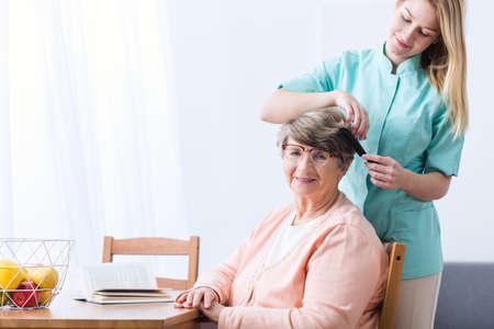 assisting: Photo of alzheimer elderly woman and carer Stock Photo