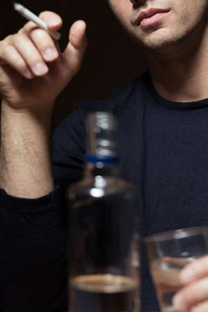 the drinker: Young man is a drinker with lots of problems
