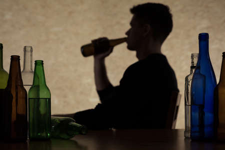 too much: Young man is drinking too much alcohol