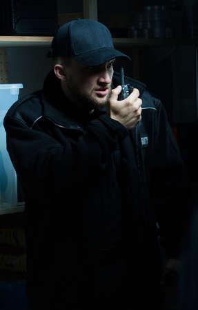 patrolling: Big policeman in uniform patrolling the area at night Stock Photo