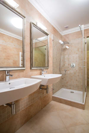 roomy: Clear and beige bathroom in the house