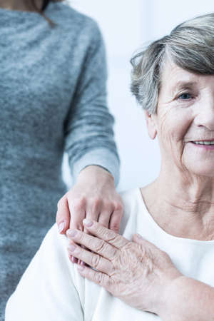 afflictions: Picture of elderly female with positive attitude having support Stock Photo