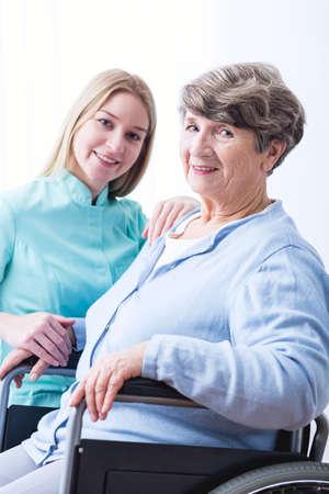 cheerfulness: Photo of sick senior woman and cheerfulness carer Stock Photo