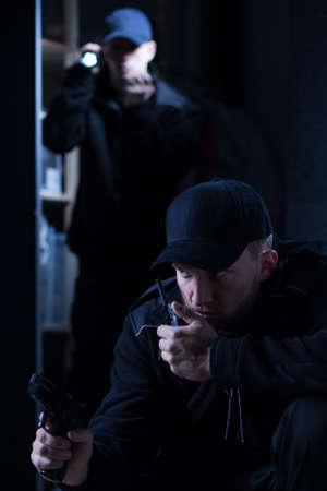 suspect: Two cops looking for suspect in dark room
