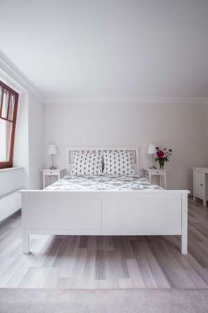tasteful: White and tasteful furnitures in a bedroom Stock Photo
