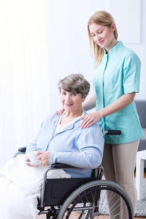 afflictions: Picture of carer supporting old woman with health afflictions