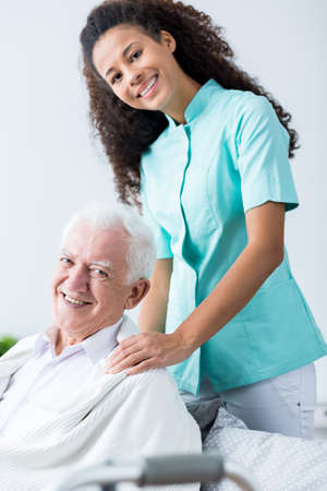 medical worker: Older man and his carer at home Stock Photo