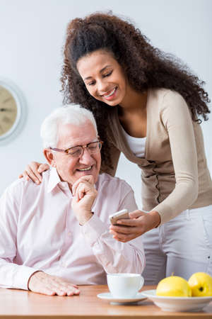granddaughter: Grandfather and adult granddaughter spending time together Stock Photo