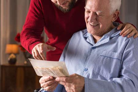 Photo of elderly man with critical illness having positive attitude