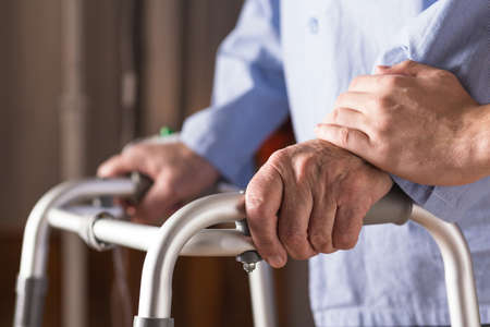 hypertension: Image of senior disabled person holding walking zimmer Stock Photo