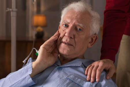 home health care: Portrait of sad elderly man suffering from dementia