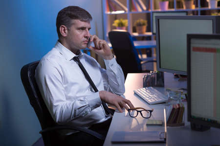 after hours: Good boss is working after hours in his office