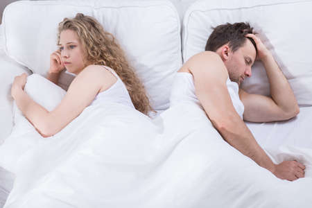 unsecure: Girl is awake and turned back to her sleeping boyfriend