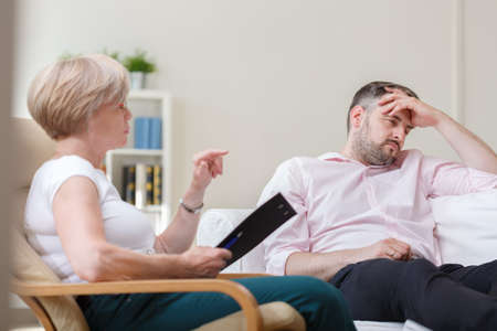 psychoanalysis: Image of depressed man during session with therapist