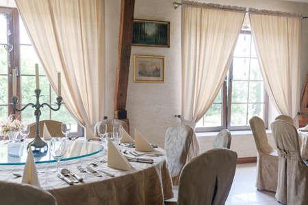 flatware: Flatware and napkins on elegant round tables Stock Photo