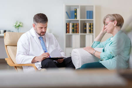 home visit: Image of doctor with ill patient during private home visit