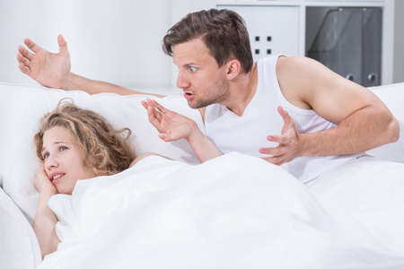 husband: Young couple is having fight in bed Stock Photo