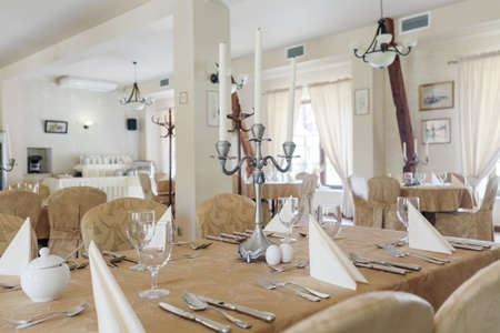 room decor: Tableware on the table in luxury banquet hall