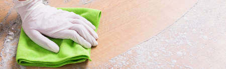 precise: Precise maid is using a cloth in her work Stock Photo