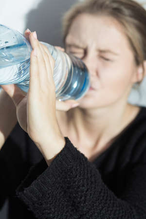 sadness: Image of girl with water during starvation diet