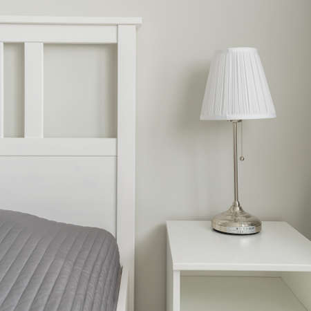 sharply: Close-up of space near bed designed in simple way