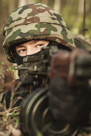 automatic: Closeup of military soldier with automatic weapon