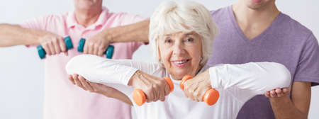 healthier: After fitness old lady feels younger and healthier Stock Photo