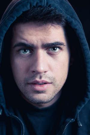 hoody: Portrait of young male hacker in black hoody