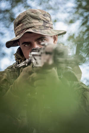 fatigues: Closeup of army sniper with automatic weapon