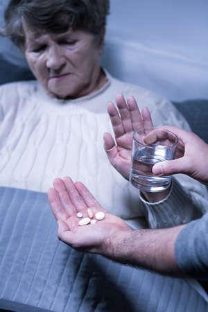 refuse: Image of senior ill woman refuse medical treatment Stock Photo