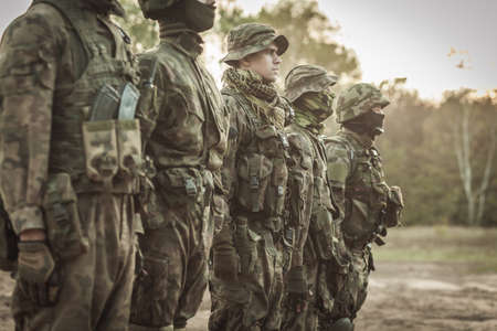 fatigues: Soldiers at rifle drill on training groung