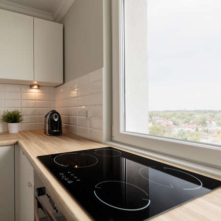 functional: Image of functional light kitchen in new flat Stock Photo