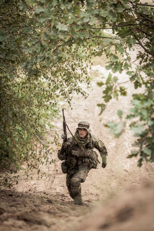 men running: Soldier bounding toward objective during field training